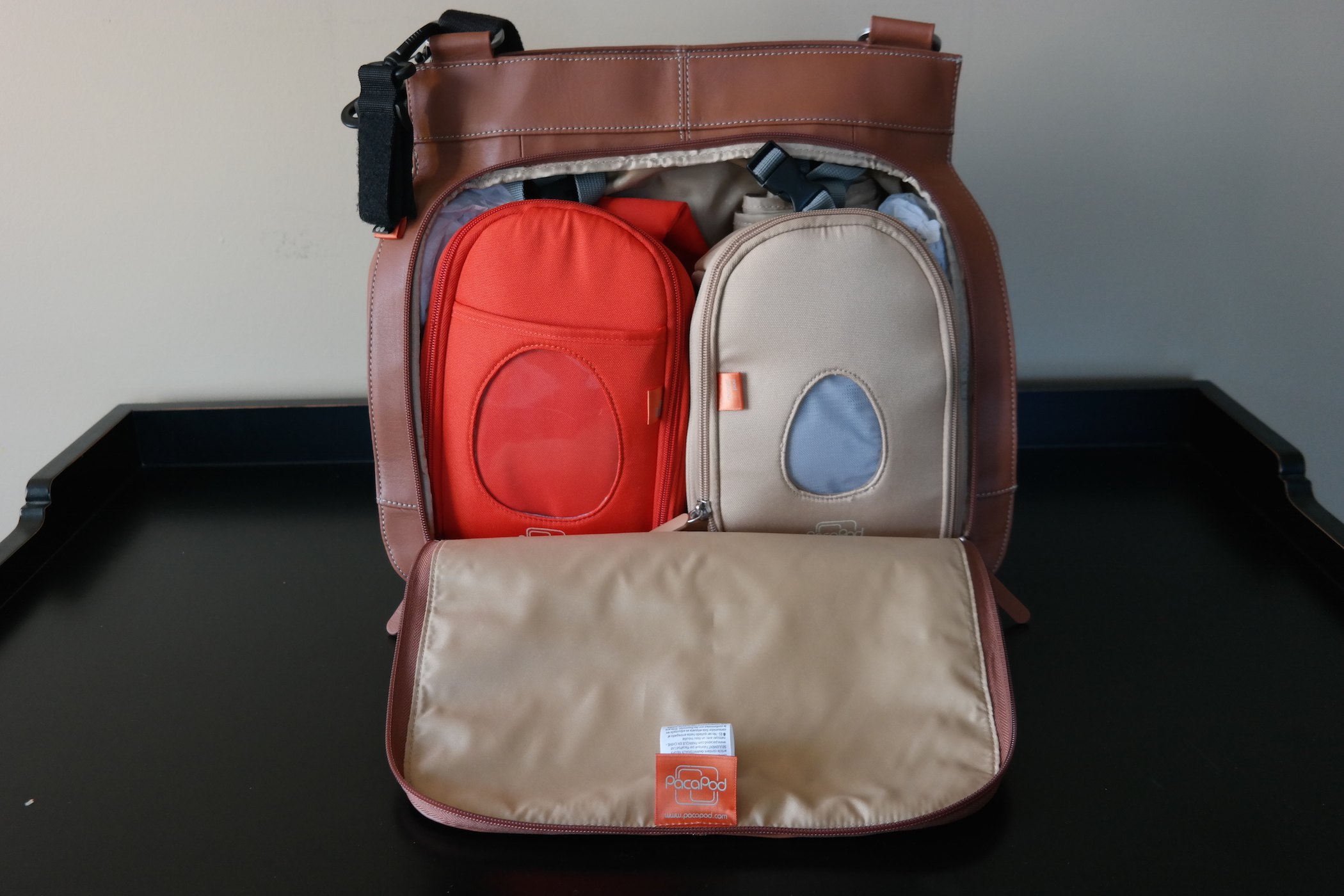 c43e8f6adca To truly assess this diaper bag and its effectiveness, I am going to take  everything out of my existing packed diaper bag and move it in to the new  PacaPod.
