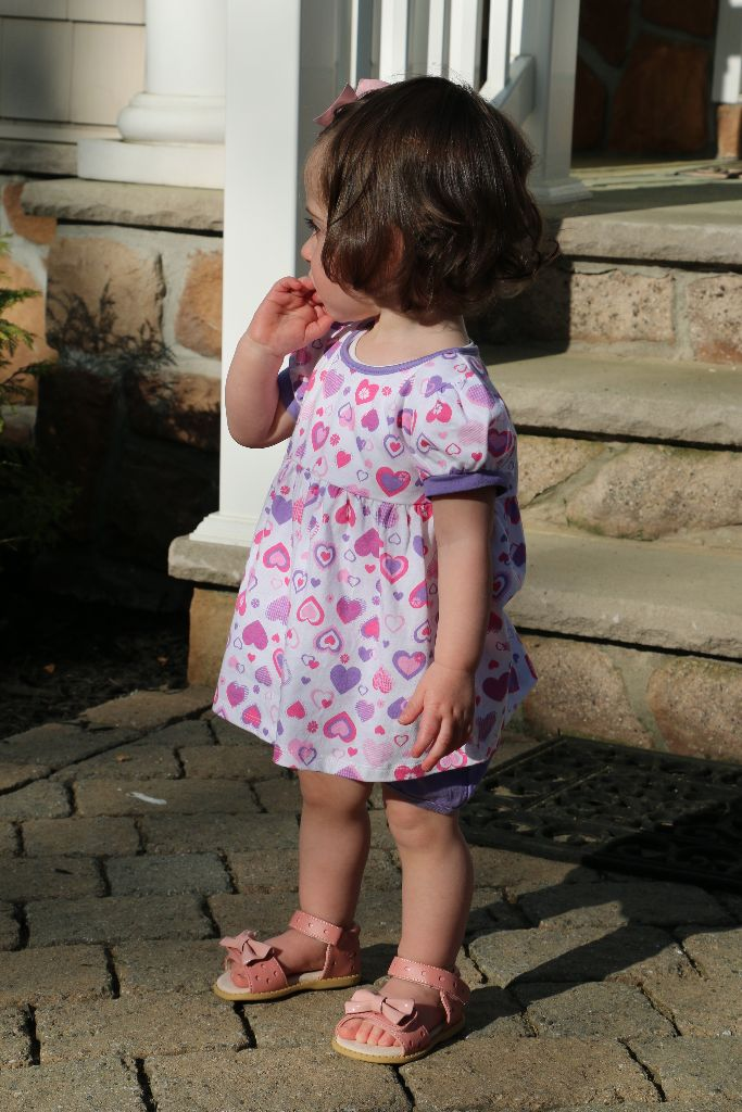 A wearing her Livie & Luca sandals.